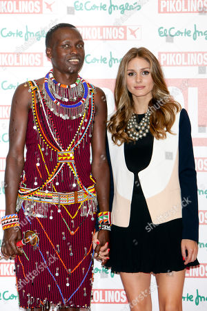 Stock Photo of Olivia Palermo and William Kikanae Masai leader William Kikanae and actress and model Olivia Palermo poses to present the new 'Pikolinos' Maasai collection at the Corte Ingles Castellana store in Madrid, Spain