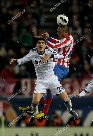 Alvaro Morata, Joao Miranda Real Madrid's Alvaro Morata, left, in action with Atletico de Madrid's Joao Miranda from Brazil, right, during a Spanish La Liga soccer match at the Vicente Calderon stadium in Madrid, Spain
