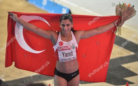Stock Image of Nevin Yanit Turkey's Nevin Yanit pose with the national flag after winning the women's 60m hurdles final, during the Athletics European Championships in Gothenburg, Sweden