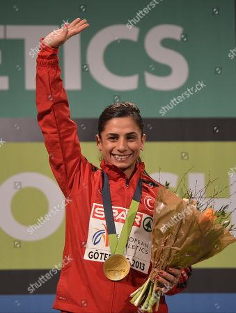 Stock Photo of Nevin Yanit Turkey's Nevin Yanit poses with her gold medal for women's 60m hurdles, during the Athletics European Championships in Gothenburg, Sweden