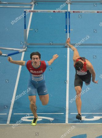Erik Balnuweit, Sergey Shubenkov Russia's Sergey Shubenkov, left, finishes to win the men's 60m hurdles final, during the Athletics European Championships in Gothenburg, Sweden, . Germany's Erik Balnuweit is at right