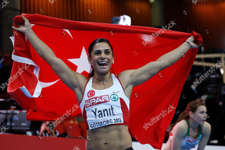 Turkey's Nevin Yanit celebrates with her country's flag after winning the gold medal in the women's 60m hurdles final during the Athletics European Championships in Gothenburg, Sweden