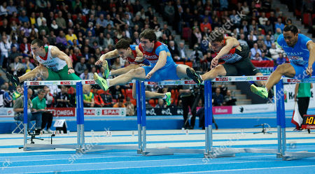 Hungary's Balazs Baji, Russia's Konstantin Shabanov, Russia's Sergey Shubenkov, Germany's Erik Balnuweit and Italy's Paolo Dal Molin clear a hurdle in the men's 60m hurdles final during the Athletics European Championships in Gothenburg, Sweden