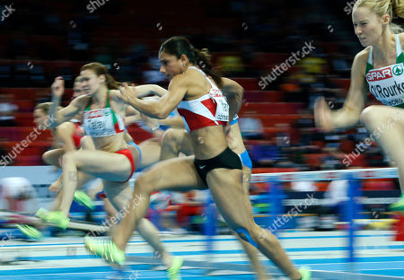Turkey's Nevin Yanit, center, runs to win the gold medal in the women's 60m hurdles final during the Athletics European Championships in Gothenburg, Sweden