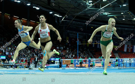 Stock Picture of Turkey's Nevin Yanit, center, crosses the finish line ahead of fourth placed Ireland's Derval O'Rourke, right, and third placed Italy's Veronica Borsi, left, in the final of the women's 60m hurdles during the Athletics European Championships in Gothenburg, Sweden