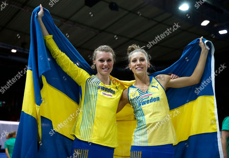 Sweden's silver medal winner Ebba Jungmark, right, and her teammate Emma Green Tregaro, bronze, celebrate with their countries flag after the women's high jump final during the Athletics European Indoor Championships in Gothenburg, Sweden