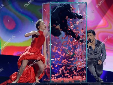 Farid Mammadov, right, of Azerbaijan performs his song Hold Me during a rehearsal for the second semifinal of the Eurovision Song Contest at the Malmo Arena in Malmo, Sweden, . The contest run by European television broadcasters the event being held in Sweden as they won the competition in 2012, the final is held May 18