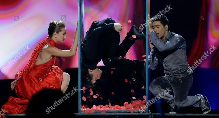 Farid Mammadov, right, of Azerbaijan performs his song Hold Me during the second semifinal of the Eurovision Song Contest at the Malmo Arena in Malmo, Sweden, . The contest is run by European television broadcasters with the event being held in Sweden as they won the competition in 2012, the final will be held in Malmo on May 18