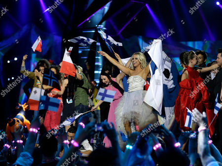 Krista Siegfrids, center, of Finland celebrates with other contestants making it though to the final after the vote counting following the second semifinal of the Eurovision Song Contest at the Malmo Arena in Malmo, Sweden, . The final of the contest run by European television broadcasters will be held May 18