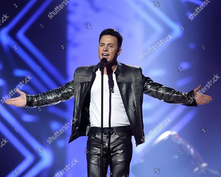 """Stock Photo of Ryan Dolan of Ireland performs his song """"Only Your Love Survives"""" during a rehearsal for the final of the Eurovision Song Contest at the Malmo Arena in Malmo, Sweden, . The contest is run by European television broadcasters with the event being held in Sweden as they won the competition in 2012, the final will be held in Malmo on May 18"""