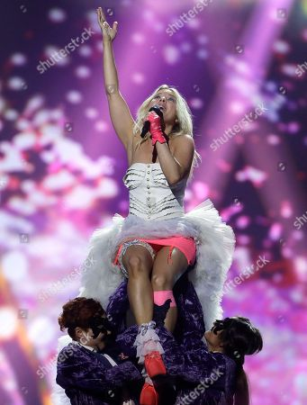 """Krista Siegfrids, of Finland performs her song """"Marry Me"""" during a rehearsal for the final of the Eurovision Song Contest at the Malmo Arena in Malmo, Sweden, . The contest is run by European television broadcasters with the event being held in Sweden as they won the competition in 2012, the final will be held in Malmo on May 18"""
