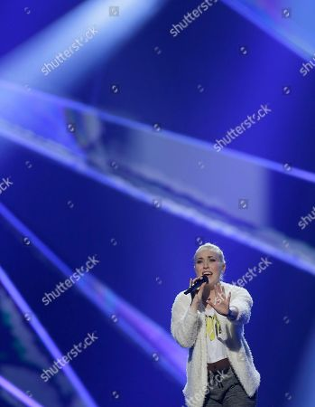"""Stock Photo of Margaret Berger of Norway performs her song """"I Feed You My Love"""" during a rehearsal for the final of the Eurovision Song Contest at the Malmo Arena in Malmo, Sweden, . The contest is run by European television broadcasters with the event being held in Sweden as they won the competition in 2012, the final will be held in Malmo on May 18"""