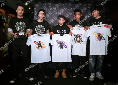 Jaden Smith, JJ Lin, Moises Arias, Mateo Arias, Brandon Chang Singaporean singer JJ Lin, right, U.S. actor Jaden Smith, second right, and their casual wear trade copartners, from center to left, show off their products during their promotion event in Taipei, Taiwan