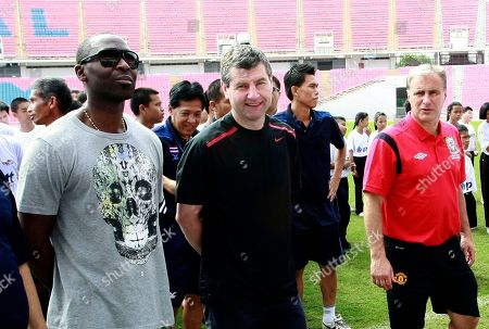 Clayton Blackmore, Andy Cole, Denis Irwin Former Manchester United soccer players from left, Andy Cole, Denis Irwin and Clayton Blackmore wait before a soccer clinic at the Rajamangala national stadium in Bangkok, Thailand . The players are in Thailand as guest of the Thai senior soccer association and to promote the world senior soccer tournament to be held in Thailand this moth