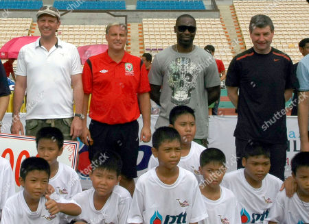 Lee Sharpe, Clayton Blackmore, Andy Cole, Denis Irwin Former Manchester United soccer players from Lee Sharpe, Clayton Blackmore, Andy Cole and Denis Irwin pose with Thai boys after a soccer clinic at the Rajamangala national stadium in Bangkok, Thailand . The players are in Thailand as guest of the Thai senior soccer association and to promote the world senior soccer tournament to be held in Thailand this moth