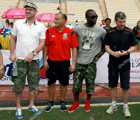 Lee Sharpe, Clayton Blackmore, Andy Cole, Denis Irwin Former Manchester United soccer players from left, Lee Sharpe, Clayton Blackmore, Andy Cole and Denis Irwin wait before a soccer clinic at the Rajamangala national stadium in Bangkok, Thailand . The players are in Thailand as guest of the Thai senior soccer association and to promote the world senior soccer tournament to be held in Thailand this moth