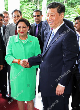 Xi Jinping, Kamla Persad-Bissessar China's President Xi Jinping, right, shakes hands with Trinidad & Tobago's Prime Minister Kamla Persad-Bissessar upon his arrival to the Diplomatic Center in St. Ann's, Trinidad, . Officials announced Trinidad plans to open an embassy in Beijing later this year, and Persad-Bissessar will make an official visit to China in November. Jinping is also traveling to Mexico, Costa Rica and the U.S
