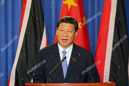 Xi Jinping, Kamla Persad-Bissessar China's President Xi Jinping speaks during a joint news conference with Trinidad & Tobago's Prime Minister Kamla Persad-Bissessar, unseen, at the Diplomatic Center in St. Ann's, Trinidad, . Xi Jinping announced China was awarding Trinidad a $250 million loan to build a children's hospital during the first stop of his four-country regional tour in the Americas. He's also traveling to Mexico, Costa Rica and the U.S