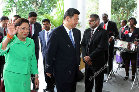 Xi Jinping, Kamla Persad-Bissessar China's President Xi Jinping, center, is welcomed by Trinidad & Tobago's Prime Minister Kamla Persad-Bissessar, waving, to the Diplomatic Center in St. Ann's, Trinidad, . Xi Jinping met for the first time with officials in Trinidad and Tobago Saturday on the first stop of a four-country regional tour. He's also traveling to Mexico, Costa Rica and the U.S