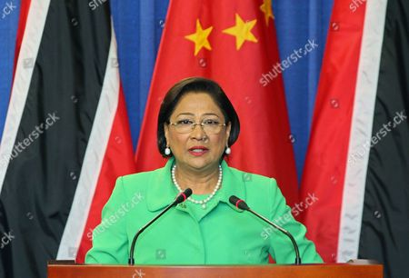 Xi Jinping, Kamla Persad-Bissessar Trinidad & Tobago's Prime Minister Kamla Persad-Bissessar speaks during a joint news conference with China's President Xi Jinping, unseen, at the Diplomatic Center in St. Ann's, Trinidad, . Xi announced China was awarding Trinidad a $250 million loan to build a children's hospital during the first stop of his four-country regional tour in the Americas. He's also traveling to Mexico, Costa Rica and the U.S