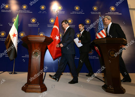 """John Kerry, Ahmet Davutoglu, Moaz al-Khatib U.S. Secretary of State John Kerry, right, Turkish Foreign Minister Ahmet Davutoglu, left, and Syrian opposition leader Moaz al-Khatib arrive for a joint news conference after a """"Friends of Syria"""" group meeting at the Adile Sultan Palace, in Istanbul, Turkey. The United States said Sunday that it will double its non-lethal assistance to Syria's opposition as the rebels' top supporters vowed to enhance and expand their backing of the two-year battle to oust President Bashar Assad's regime"""