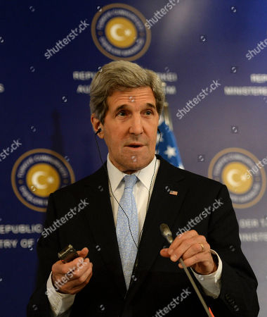"""John Kerry U.S. Secretary of State John Kerry speaks to the media with Turkish Foreign Minister Ahmet Davutoglu and Syrian opposition leader Moaz al-Khatib, after a """"Friends of Syria"""" group meeting at the Adile Sultan Palace early, in Istanbul, Turkey. Kerry announced an expansion of non-lethal aid to the Syrian opposition"""