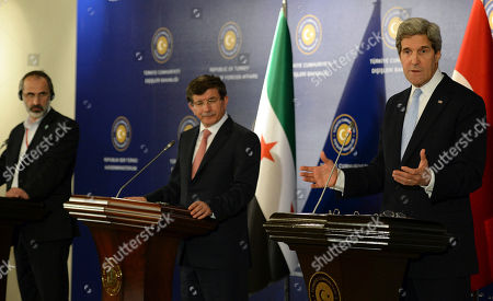 """John Kerry, Ahmet Davutoglu, Moaz al-Khatib U.S. Secretary of State John Kerry, right, Turkish Foreign Minister Ahmet Davutoglu, center, and Syrian opposition leader Moaz al-Khatib address the media after a """"Friends of Syria"""" group meeting at the Adile Sultan Palace, in Istanbul, Turkey. The United States said Sunday that it will double its non-lethal assistance to Syria's opposition as the rebels' top supporters vowed to enhance and expand their backing of the two-year battle to oust President Bashar Assad's regime"""