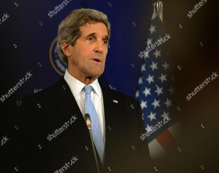 """John Kerry U.S. Secretary of State John Kerry speaks to the media with Turkish Foreign Minister Ahmet Davutoglu and Syrian opposition leader Moaz al-Khatib after a """"Friends of Syria"""" group meeting at the Adile Sultan Palace early, in Istanbul, Turkey. Kerry announced an expansion of non-lethal aid to the Syrian opposition"""
