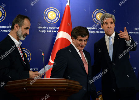 """John Kerry, Ahmet Davutoglu, Moaz al-Khatib U.S. Secretary of State John Kerry, right, Turkish Foreign Minister Ahmet Davutoglu, center, and Syrian opposition leader Moaz al-Khatib walk to pose for pictures after a """"Friends of Syria"""" group meeting at the Adile Sultan Palace, in Istanbul, Turkey. The United States said Sunday that it will double its non-lethal assistance to Syria's opposition as the rebels' top supporters vowed to enhance and expand their backing of the two-year battle to oust President Bashar Assad's regime"""
