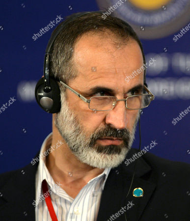 """Stock Picture of Moaz al-Khatib Syrian opposition leader Moaz al-Khatib listens during a joint news conference with U.S. Secretary of State John Kerry and Turkish Foreign Minister Ahmet Davutoglu after a """"Friends of Syria"""" group meeting at the Adile Sultan Palace, in Istanbul, Turkey. The United States said Sunday that it will double its non-lethal assistance to Syria's opposition as the rebels' top supporters vowed to enhance and expand their backing of the two-year battle to oust President Bashar Assad's regime"""