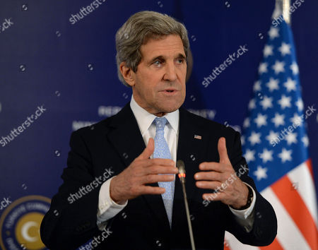 """Stock Image of John Kerry U.S. Secretary of State John Kerry speaks to the media with Turkish Foreign Minister Ahmet Davutoglu and Syrian opposition leader Moaz al-Khatib, unseen, after a """"Friends of Syria"""" group meeting at the Adile Sultan Palace early, in Istanbul, Turkey. The United States said Sunday that it will double its non-lethal assistance to Syria's opposition as the rebels' top supporters vowed to enhance and expand their backing of the two-year battle to oust President Bashar Assad's regime"""