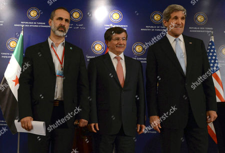 """John Kerry, Ahmet Davutoglu, Moaz al-Khatib U.S. Secretary of State John Kerry, right, Turkish Foreign Minister Ahmet Davutoglu, center, and Syrian opposition leader Moaz al-Khatib pose for photos after a """"Friends of Syria"""" group meeting at the Adile Sultan Palace, in Istanbul, Turkey. The United States said Sunday that it will double its non-lethal assistance to Syria's opposition as the rebels' top supporters vowed to enhance and expand their backing of the two-year battle to oust President Bashar Assad's regime"""