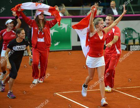 Canada tennis team Eugenie Bouchard, Sharon Fichman, Stephanie Dubois and Gabriela Dabrowski celebrate victory over Ukraine at the Fed Cup match in Kiev, Ukraine