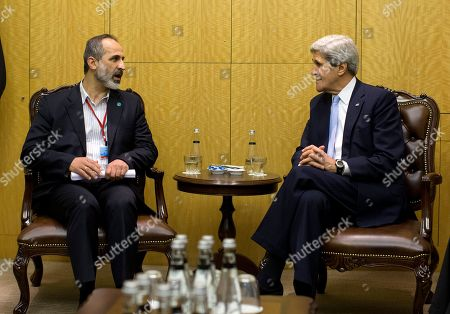 """John Kerry, Moaz al-Khatib U.S. Secretary of State John Kerry meets with Syrian opposition leader Moaz al-Khatib, left, in Istanbul, Turkey. Kerry is meeting with the """"Friends of Syria"""" group to discuss the ongoing hostilities in Syria"""
