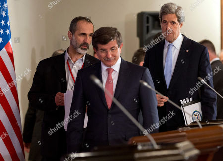 """Stock Photo of John Kerry, Ahmet Davutoglu, Moaz al-Khatib U.S. Secretary of State John Kerry, right, arrives for a news conference with Turkish Foreign Minister Ahmet Davutoglu, center, and Syrian opposition leader Moaz al-Khatib after a """"Friends of Syria"""" group meeting at the Adile Sultan Palace, in Istanbul, Turkey. Kerry announced an expansion of non-lethal aid to the Syrian opposition"""