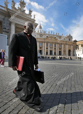 Robert Sarah Cardinal Robert Sarah, of Guinea, walks in St. Peter's Square after attending a cardinals' meeting, at the Vatican, . Cardinals from around the world have gathered inside the Vatican for their first round of meetings before the conclave to elect the next pope, amid scandals inside and out of the Vatican and the continued reverberations of Benedict XVI's decision to retire
