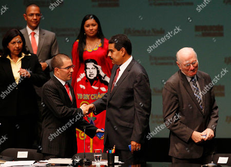 Jorge Arreaza, Nicolas Maduro, Jorge Giordani, Aloha Nunez, Ernesto Villegas Venezuela's President Nicolas Maduro, left, shake hands with Venezuela's Vice President Jorge Arreaza, left, during a minister swearing ceremony in Caracas, Venezuela, Monday, April, 22, 2013. President Maduro was sworn in on Monday to his cabinet, which kept many of the employees it inherited from the late president Hugo Chavez. New Planning Minister Jorge Giordani, on the right corner; Minister of Indigenous Peoples Aloha Nunez, in the back center with a red dress; and on her left Minister of Communication Ernesto Villegas