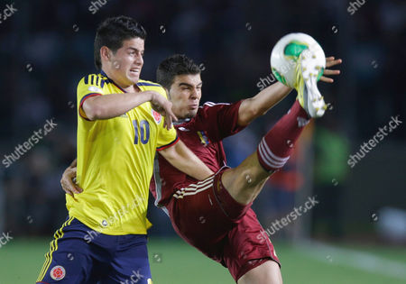 James Rodriguez, Alexander Gonzalez Colombia's James Rodriguez, left, fights for the ball with Venezuela's Alexander Gonzalez during a World Cup 2014 qualifying soccer match in Puerto Ordaz, Venezuela