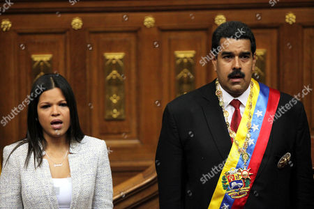 Stock Photo of Nicoals Maduro, Maria Gabriela Chavez Daughter of the late Hugo Chavez, Maria Gabriela Chavez and Venezuela's newly sworn-in President Nicolas Maduro, join in the singing of their national anthem in the National Assembly, in Caracas, Venezuela. In a July 23, 2014 closed-door meeting July at U.N. headquarters in New York, Venezuela quietly secured the backing of Latin America and the Caribbean to obtain a seat on the United Nations Security Council. Maria Gabriela Chavez is Venezuela's alternate ambassador to the U.N