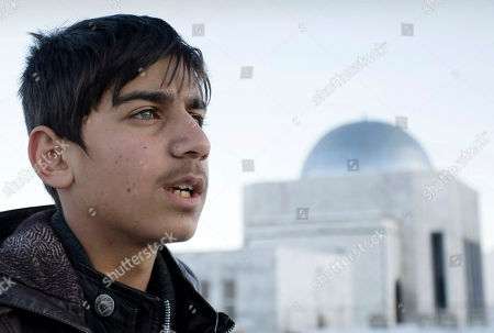 """Fawad Mohammadi Afghan actor Fawad Mohammadi, 14, speaks during an interview with The Associated Presson Nader Khan's hill, one of the areas where a part of the Afghani Oscar nominated short film titled """"Buzkashi Boys"""" was shot in Kabul, Afghanistan. Fawad Mohammadi has spent half his life peddling maps and dictionaries to foreigners in the main tourist district in Kabul. Now the 14-year-old Afghan boy with beautiful green eyes is getting ready for his first airplane ride and a trip down the red carpet at the Oscars"""