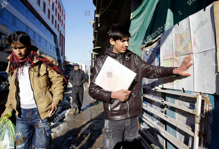 Afghan actor Fawad Mohammadi 14, adjusts a pasted map displaced to sell on Chicken St., the main tourist area in Kabul, Afghanistan. Fawad Mohammadi has spent half his life peddling maps and dictionaries to foreigners in the main tourist district in Kabul. Now the 14-year-old Afghan boy with beautiful green eyes is getting ready for his first airplane ride and a trip down the red carpet at the Oscars