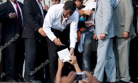 """Rafael Correa Ecuador's President Rafael Correa, center, signs autographs to supporters after receiving the Rodolfo Walsh award at the University of La Plata in La Plata, Argentina, . Argentina's Cristina Fernandez is proposing that the UNASUR group of South American nations take a common stand against """"judicial colonialism."""" That's her phrase for a U.S. judge's remedy that would force Argentina to go into default on billions of dollars in debt if it doesn't pay the funds. Correa says he's """"totally in agreement with Cristina."""" The honor from the University of La Plata was previously awarded to Venezuela's President Hugo Chavez and Bolivia's President Evo Morales"""