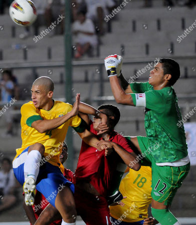 Doria, Wilder Cartagena, Angelo Campos Brazil's Doria, left, and Peru's Wilder Cartagena battle it out as Peru's goalkeeper Angelo Campos clears the ball during a U-20 South American soccer championship match against Peru in San Juan, Argentina