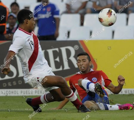 Cristian Cuevas, Wilder Cartagena Chile's Cristian Cuevas, right, fights for the ball with Peru's Wilder Cartagena during a U-20 South American soccer championship match in Mendoza, Argentina
