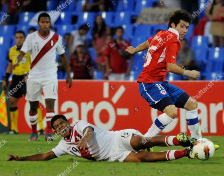 Cesar Fuentes, Wilder Cartagena Chile's Cesar Fuentes, right, fights for the ball with Peru's Wilder Cartagena during a U-20 South American soccer championship match in Mendoza, Argentina