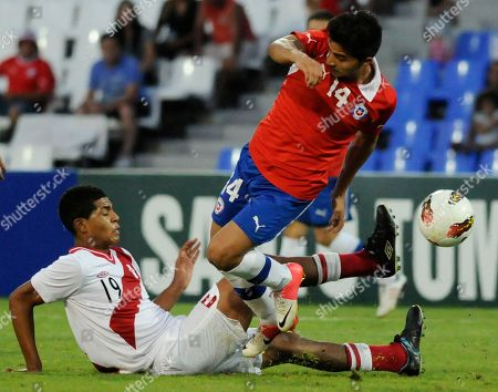 Bryan Rabello, Wilder Cartagena Chile's Bryan Rabello, top, is tackled by Peru's Wilder Cartagena during a U-20 South American soccer championship match in Mendoza, Argentina