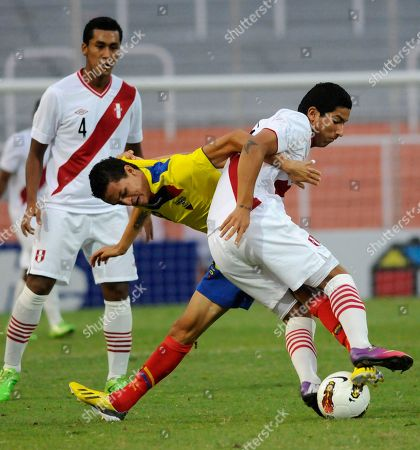 Hernan Hinostroza, Christian Ona Peru's Hernan Hinostroza, right, fights for the ball with Ecuador's Christian Ona during a U-20 South American soccer championship match in Mendoza, Argentina