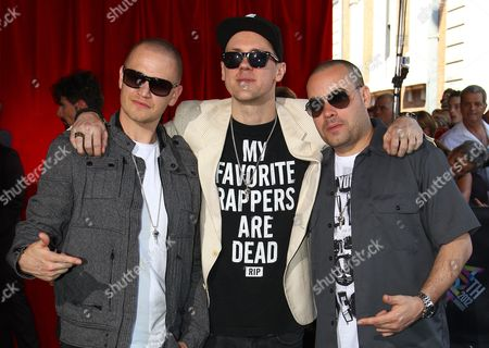Hilltop Hoods The Hilltop Hoods members, from left, Daniel Smith, Matt Lambert and Barry Francis, pose for photographers upon arrival for the Australian music industry Aria Awards in Sydney
