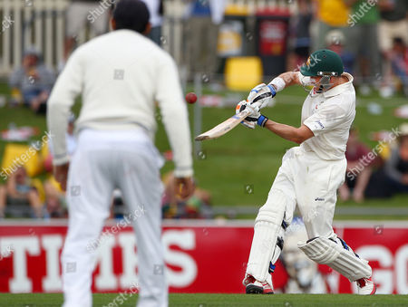 Mike Hussey Australia's Mike Hussey, right, drives the ball that brings up his 100 runs against Sri Lanka on the second day of their cricket test match at Bellerive Oval in Hobart, Australia