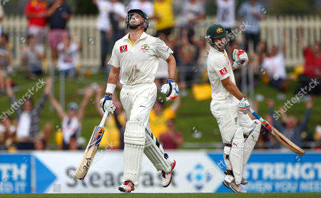 Mike Hussey, Matthew Wade Australia's Mike Hussey, left, and batting partner Matthew Wade react after Hussey made 100 runs against Sri Lanka on the second day of their cricket test match at Bellerive Oval in Hobart, Australia